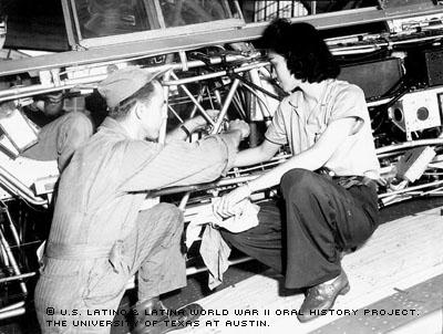Josephine Ledesma teaches a soldier how to repair the fuselage of an airplane at Randolph Field, San Antonio, TX on Jan.1942.