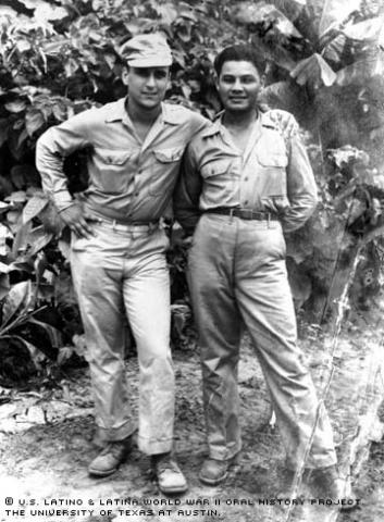 Eliseo Lopez (right) and fellow soldier Sortorio stand against the backdrop of the jungle in Bouganville, 1944.