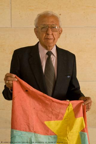 Luis Landin displays a Viet Cong flag at the AT&T Executive and Conference Center, University of Texas, Austin on Saturday, October 3, 2009. Mr. Landin attended our 10th anniversary and was interviewed by Raquel Garza. (Photo: Marc Hamel)