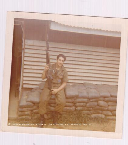Ernesto Torres at the Lane Air Field Base in front of his barracks (Hooch) in April 1971.\Holding my M16 rifle.""""