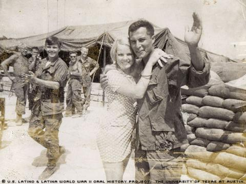 Henry Soza photographed with a Donut Dollie Red Cross volunteer in Vietnam on April 21, 1969.