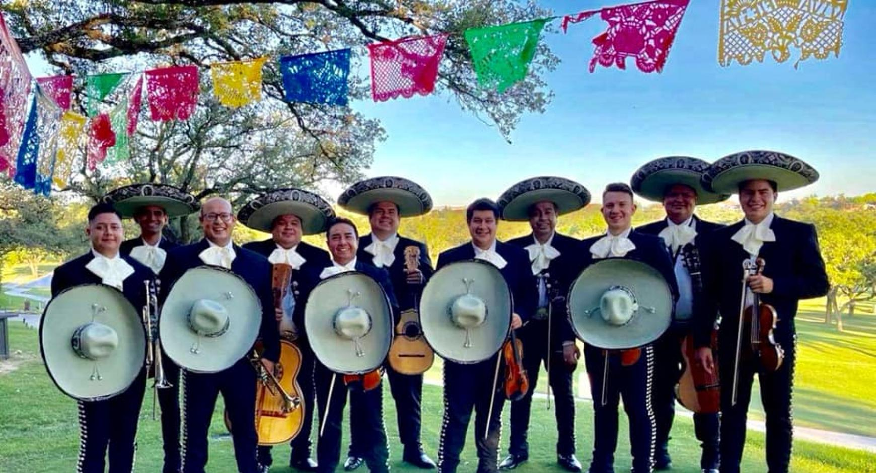 Mariachi Los Galleros in a line, holding their instruments