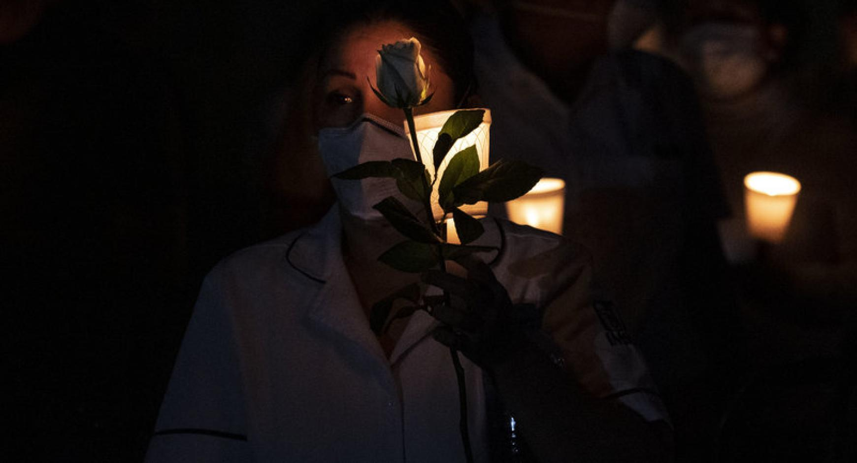 Mourners hold candles during a vigil in Baja California.